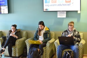 students reading in the Young building lounge