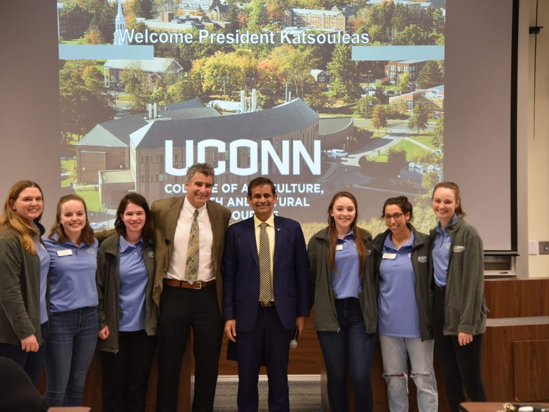After his tour, President Katsouleas spoke to members of the College in Storrs and by video conference with those at the Extension centers. Posing with President Katsouleas and Dean Chaubey are CAHNR Ambassadors (left to right) Julia Brower, Hannah Desrochers, Jenna Feyler, Kaylea Misiewicz, Victoria DeTrolia and Kirsten Krause.