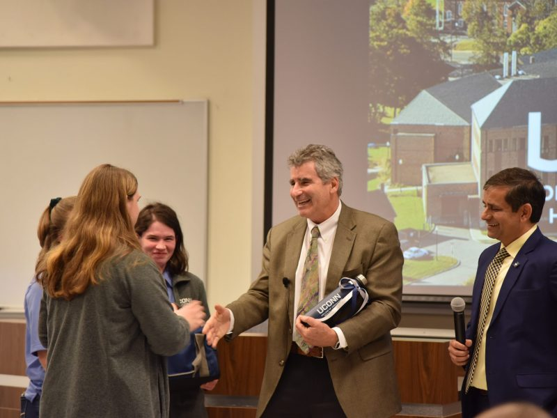 CAHNR Ambassadors presented President Katsouleas with gifts from CAHNR, which of course included UConn Creamery ice cream.