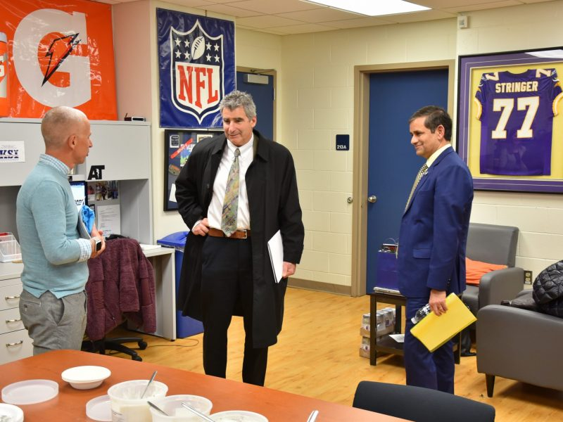 Professor Doug Casa, CEO of the Korey Stringer Institute (left), discussed the mission and work of KSI with President Katsouleas (center) and Dean Chaubey.