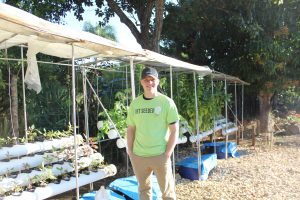 Christian Heiden with a hydroponic growing unit.