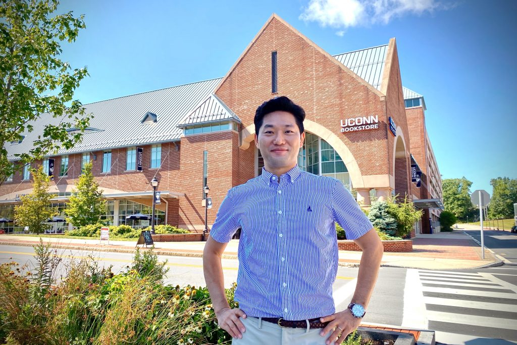 Sangyong Choi standing across the street from the UConn Bookstore in Storrs.