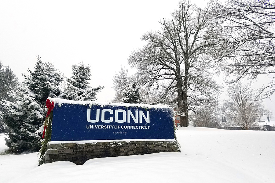 Snow covering the uconn sign