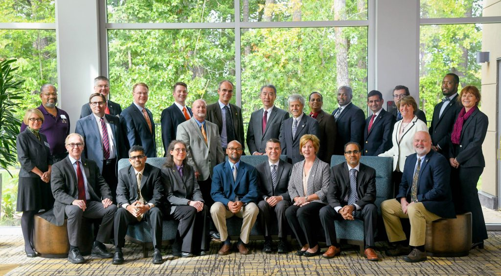 Twenty-five Fellows of the Food Systems Leadership Institute pose for a group photo.