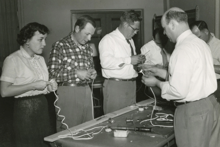 Five people working with electrical wire
